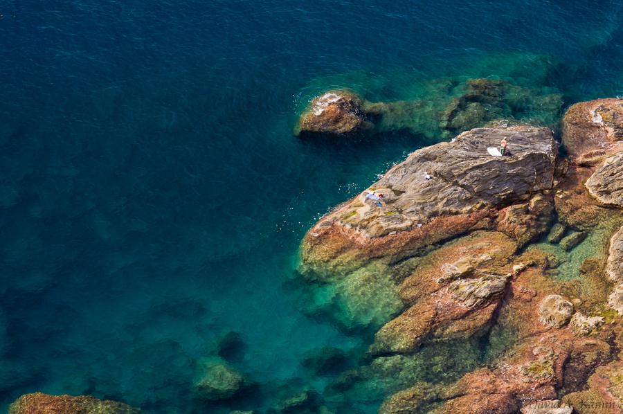 Rocky Coastline and Sunbathers - Cinque Terre, Italy