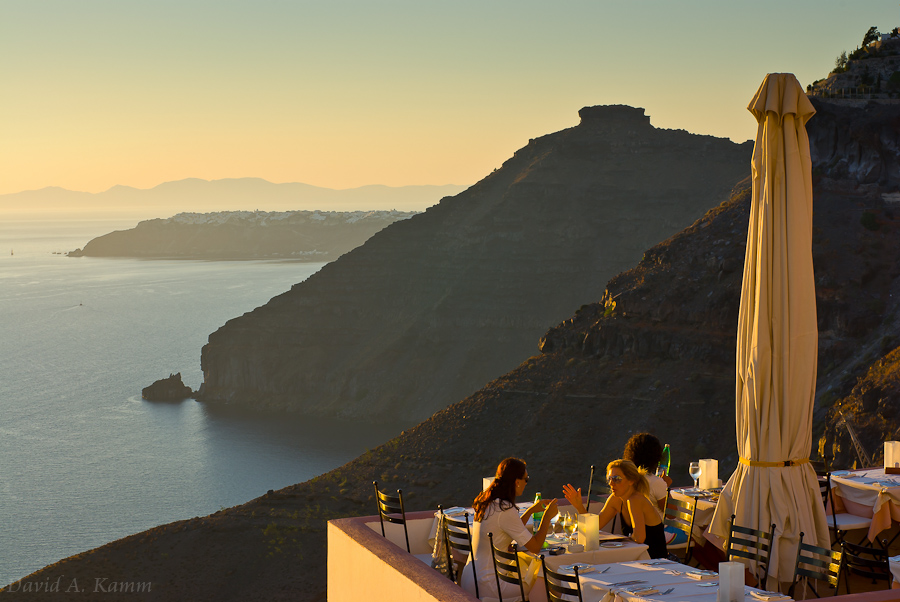 Women at a Cliffside Restaurant - Santorini, Greece